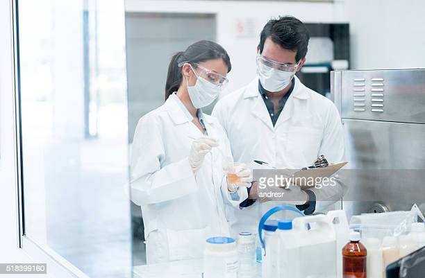 Chemists working at a the lab