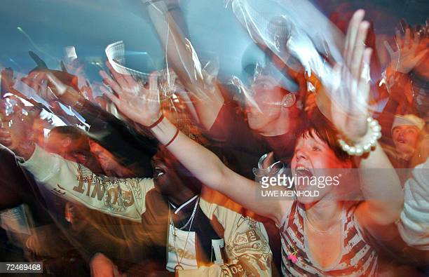 Fans of rapper 50 Cent of the US scream during his concert with his group GUnit in the eastern town of Chemnitz late 08 November 2006 AFP PHOTO...