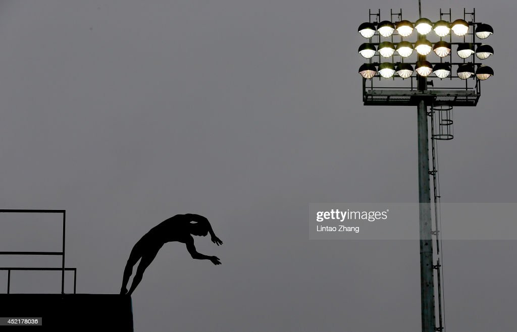 Chen Aisen of China competes in the team event of the 19th FINA Diving World Cup at the Oriental Sports Center on July 15, 2014 in Shanghai, China.