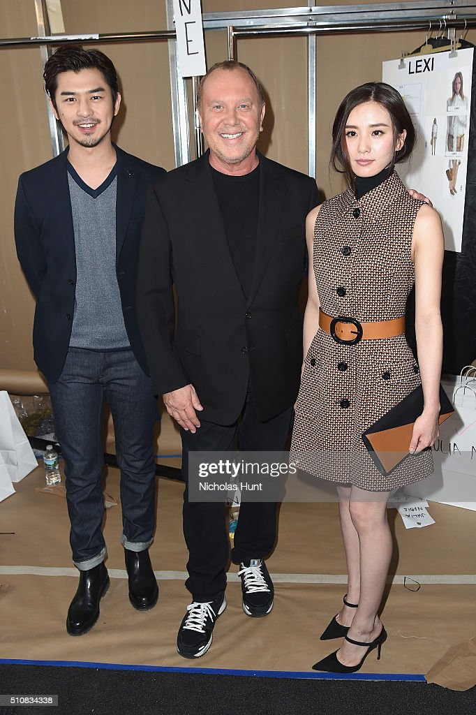 Chen Bolin, Designer Michael Kors, and Liu Shishi pose backstage at the Michael Kors Fall 2016 Runway Show during New York Fashion Week: The Shows at Spring Studios on February 17, 2016 in New York City.