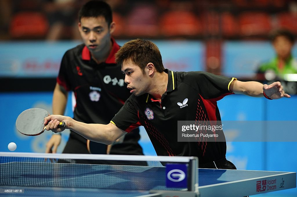 Chen Chien An (L) and Chuang Chih Yuan (R) of Chinese Taipei in action during Men's double quarter final of the 2014 ITTF World Tour Grand Finals at Huamark Indoor Stadium on December 11, 2014 in Bangkok, Thailand.
