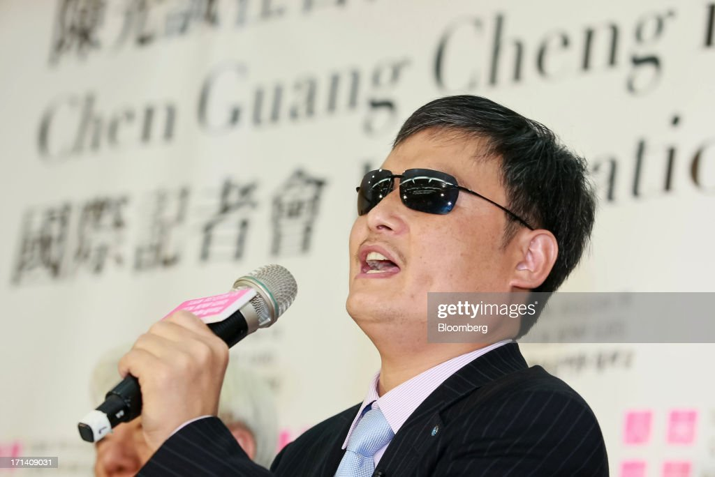 Chen Guangcheng a blind Chinese lawyer and human rights activist speaks during a news conference in Taipei Taiwan on Monday June 24 2013 Chen who...