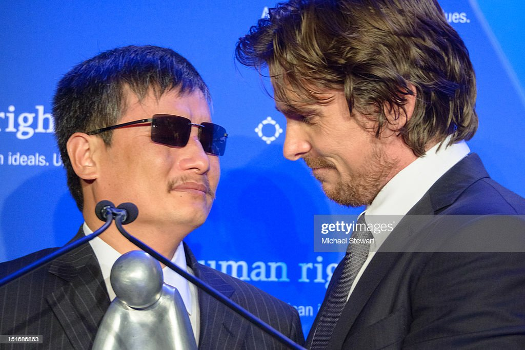 Chen Guangcheng and actor Christian Bale attend Human Rights First's Human Rights Award Dinner at Pier Sixty at Chelsea Piers on October 24 2012 in...