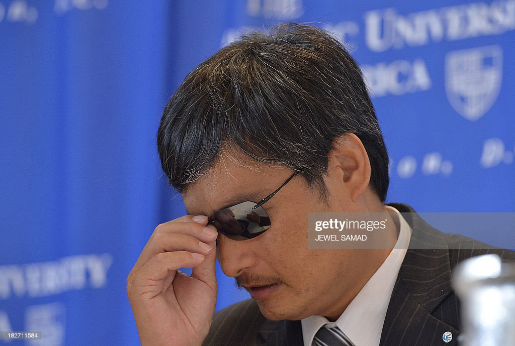 Chen Guangcheng the Chinese activist who dramatically escaped house arrest adjusts his glasses during a ceremony in Washington DC on October 2 2103...