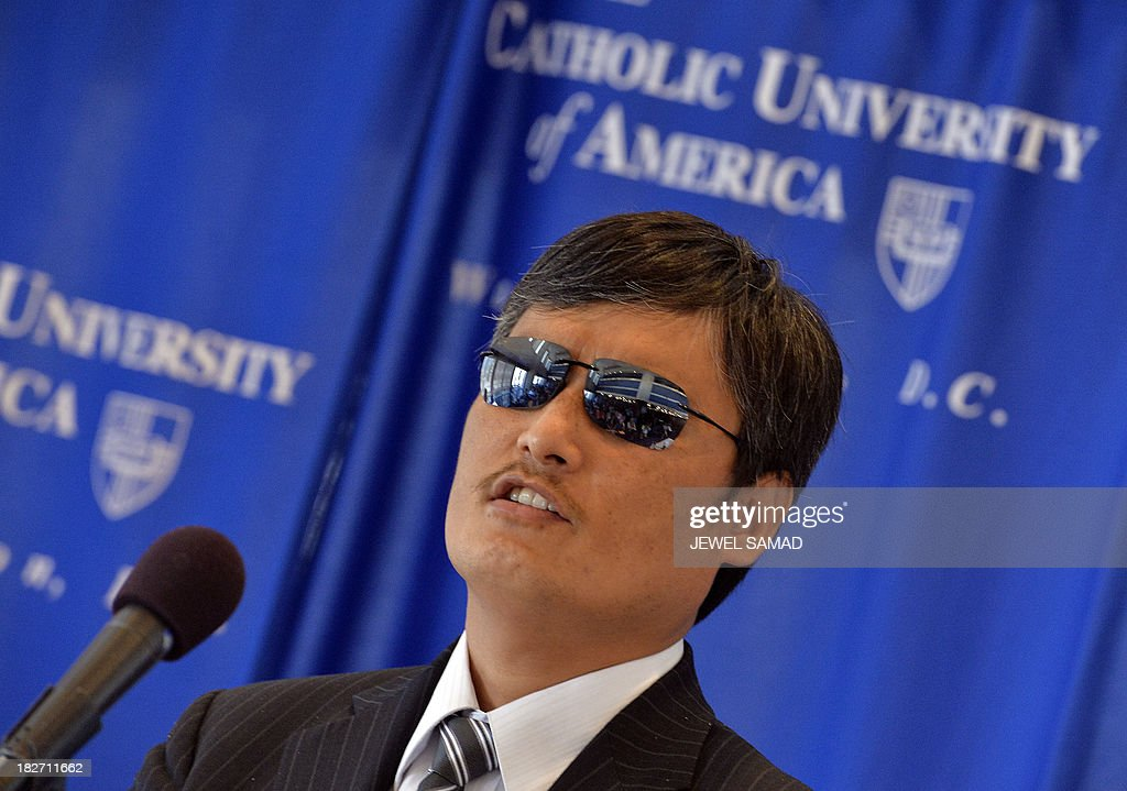 Chen Guangcheng the Chinese activist who dramatically escaped house arrest speaks during a ceremony in Washington DC on October 2 2103 Guangcheng the...