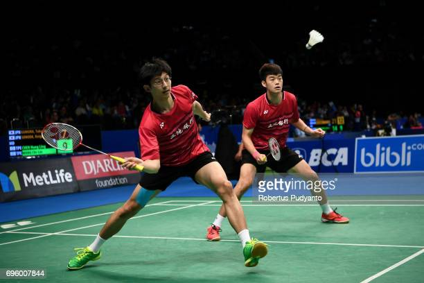 Chen Hung Ling and Wang ChiLin of Chinese Taipei compete against Takeshi Kamura and Keigo Sonoda of Japan during Mens Double Round 2 match of the BCA...
