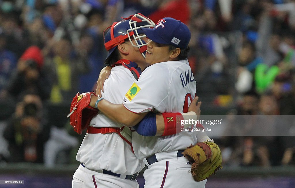 Chen Hung-Wen and Lin Hung-Yu of Chinese Taipei celebrate after winning against Netherlands during the World Baseball Classic First Round Group B match between the Netherland and Chinese Taipei at Intercontinental Baseball Stadium on March 3, 2013 in Taichung, Taiwan.