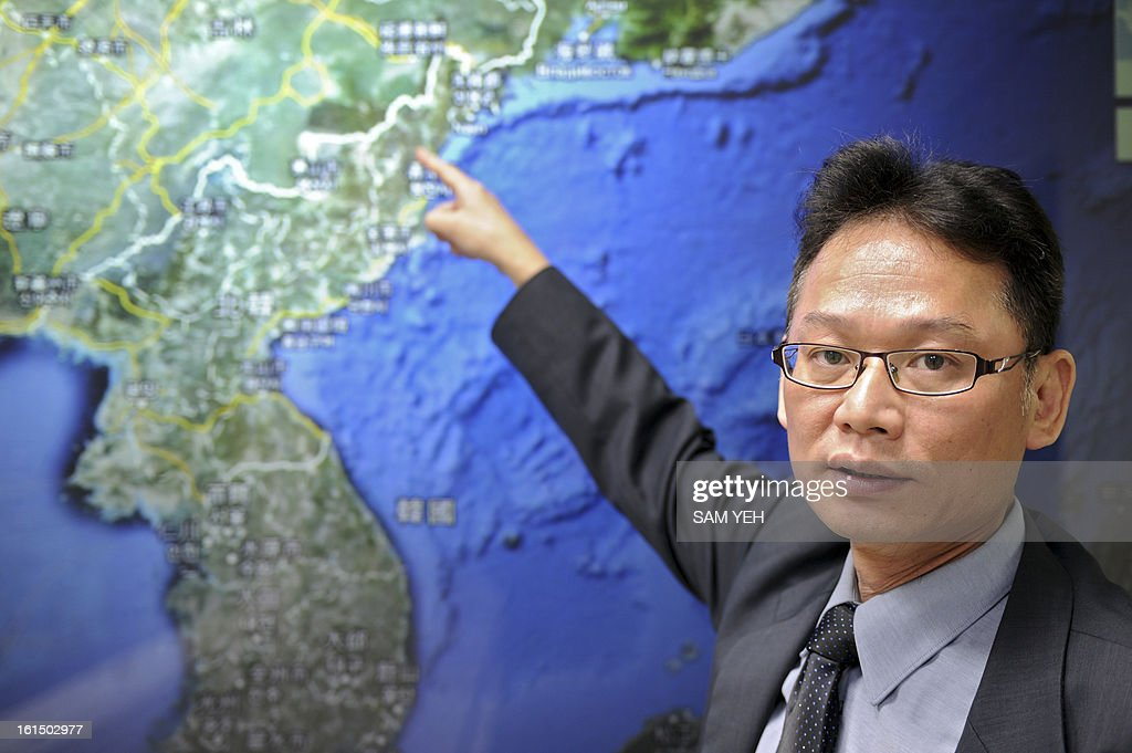Chen Kuo-chang, a senior technical specialist from Taiwan's Seismology Center points towards a North Korean map at the location that North Korea staged a nuclear test, at the Central Weather Bureau in Taipei on February 12, 2013. North Korea staged an apparent nuclear test of six to seven kilotons in a striking act of defiance that, if confirmed, is sure to trigger global condemnation from enemies and allies alike. AFP PHOTO / Sam Yeh