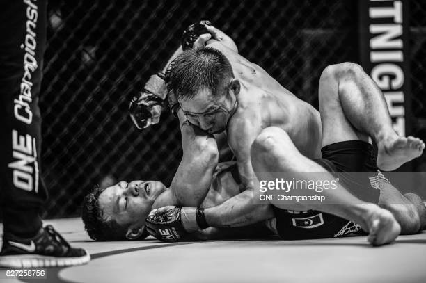 Chen Lei consistently outgrapples Saiful Merican for an armbar submission win during ONE Championship Kings And Conquerors at the Cotai Arena on...