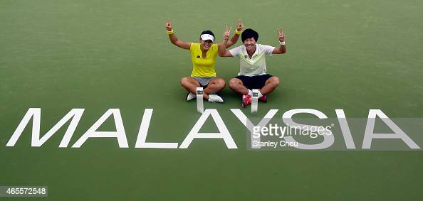 Chen Liang and Wang Yafan of China poses with the Doubles Champions Trophy after the final of the BMW Malaysian Open at the Royal Selnagor Golf Club...