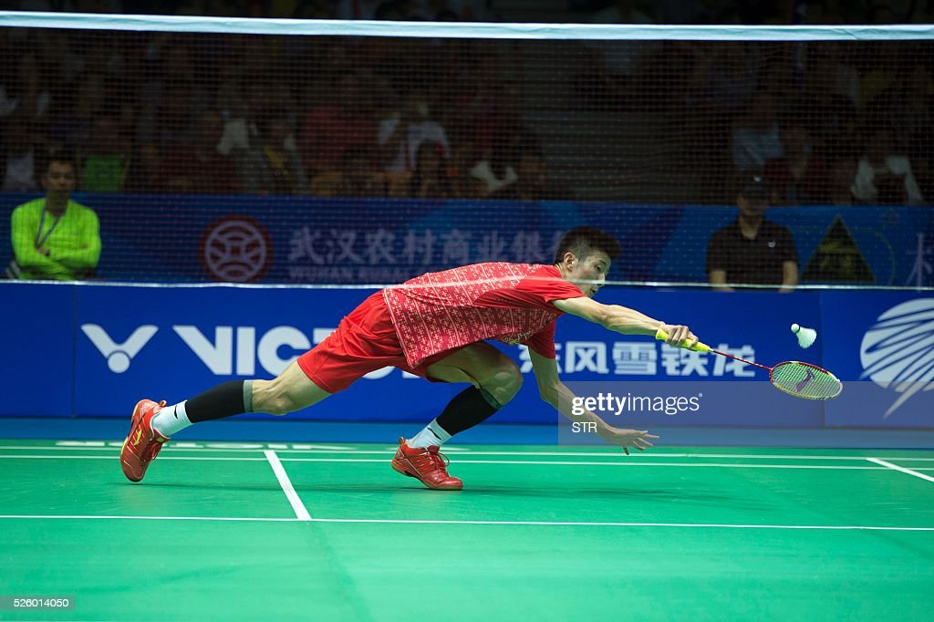 Chen Long of China hits a return against Tommy Sugiarto of India during their men's singles quarter-final match at the 2016 Badminton Asia Championships in Wuhan, central China's Hubei province on April 29, 2016. / AFP / STR