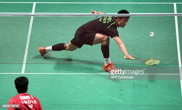 Chen Long of China hits a return during his loss to Kidambi Srikanth of India in the Australian Open men's singles badminton final in Sydney on June...