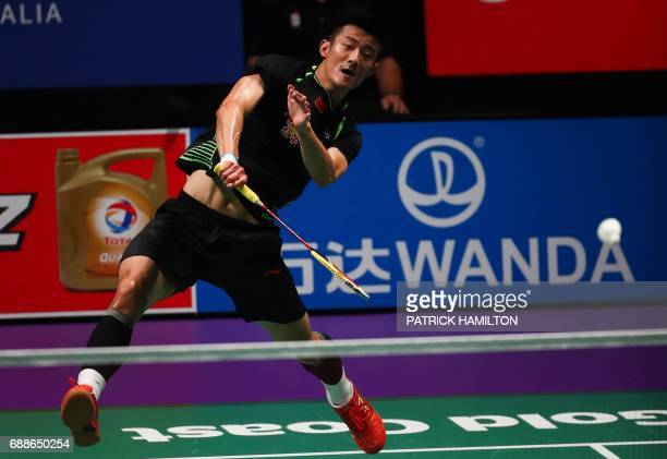 Chen Long of China hits a return during the men's singles Sudirman Cup match against India's Srikanth Kidambi at the Gold Coast Sports Centre on May...