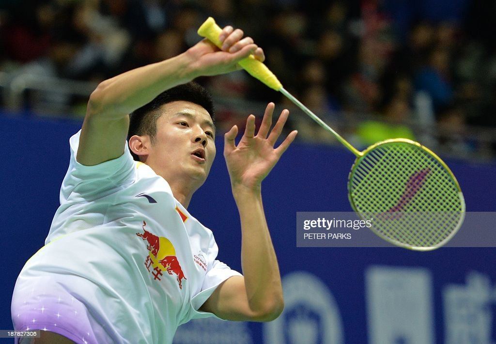 Chen Long of China hits a return to Eric Pang of the Netherlands in the men's singles first round at the China Open badminton tournament in Shanghai on November 13, 2013. Chen won the match 21-13, 21-10. AFP PHOTO/Peter PARKS