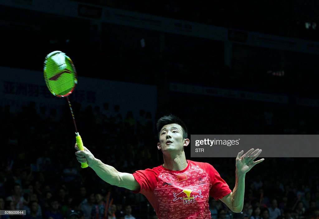 Chen Long of China hits a return to Tian Houwei of China during their men's singles semi-final match at the 2016 Badminton Asia Championships in Wuhan, central China's Hubei province on April 30, 2016. / AFP / STR