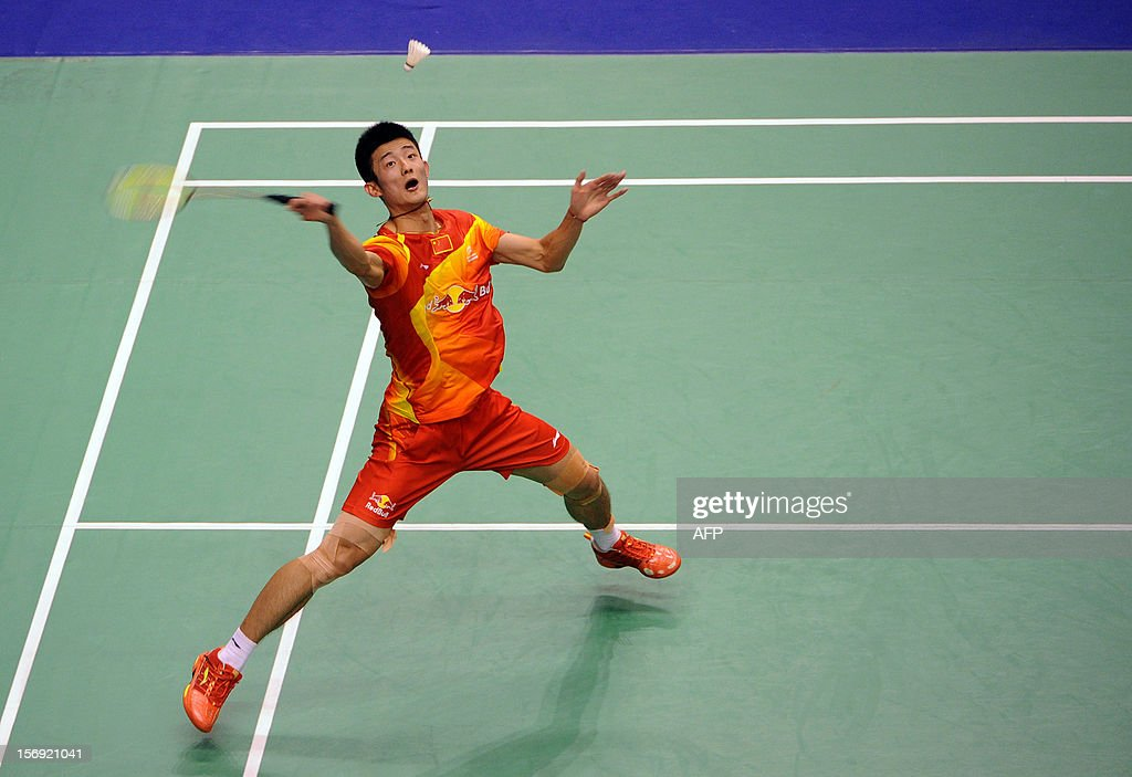 Chen Long of China hits a shot against Lee Chong Wei of Malaysia in the men's singles final at the Hong Kong Open badminton tournament on November 25, 2012. AFP PHOTO / Dale de la Rey