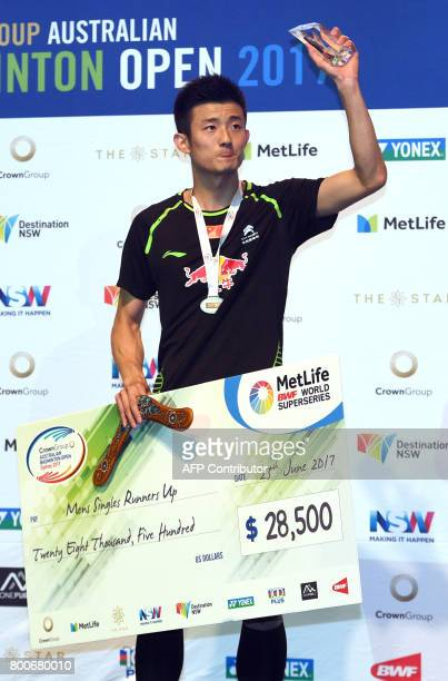 Chen Long of China holds his runnerup trophy after his loss to Kidambi Srikanth of India in the Australian Open men's singles badminton final in...