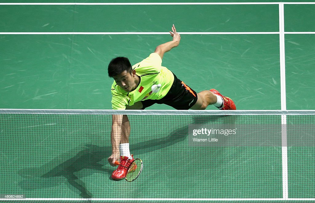 <a gi-track='captionPersonalityLinkClicked' href=/galleries/search?phrase=Chen+Long+-+Badminton+Player&family=editorial&specificpeople=9613842 ng-click='$event.stopPropagation()'>Chen Long</a> of China in action against Hans-Kristian Vittinghus of Denmark during the Men's Singles RR2 match on day two of the BWF Destination Dubai World Superseries Finals at the Hamdan Sports Complex on December 18, 2014 in Dubai, United Arab Emirates.