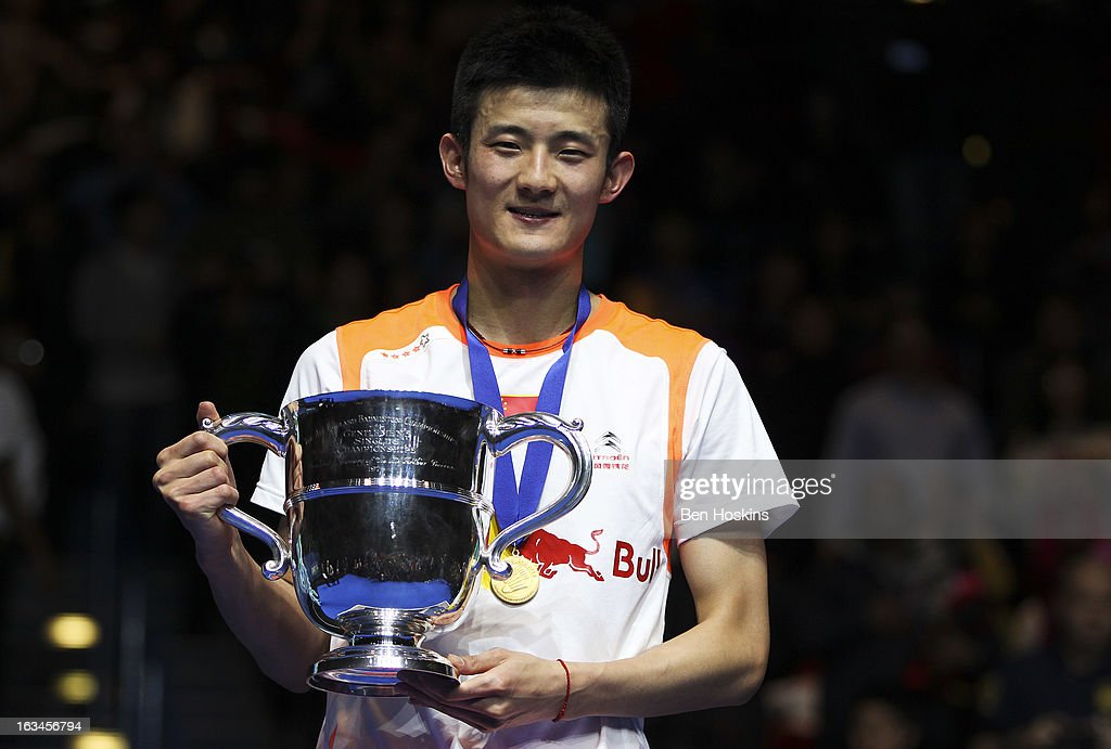 Chen Long of China lifts the men's singles trophy after defeating Lee Chong Wei of Malaysia in the final during Day 6 of the Yonex All England Badminton Open at NIA Arena on March 10, 2013 in Birmingham, England.