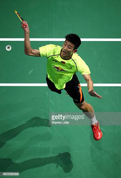 Chen Long of China plays a smash against Kenichi Tago of Japan during the Men's Singles match on day one of the BWF Destination Dubai World...