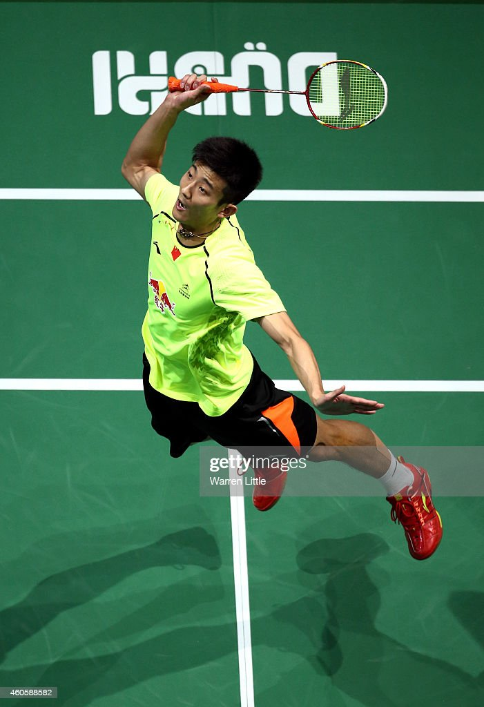 <a gi-track='captionPersonalityLinkClicked' href=/galleries/search?phrase=Chen+Long+-+Badminton+Player&family=editorial&specificpeople=9613842 ng-click='$event.stopPropagation()'>Chen Long</a> of China plays a smash against Kenichi Tago of Japan during the Men's Singles match on day one of the BWF Destination Dubai World Superseries Finals at the Hamdan Sports Complex on December 17, 2014 in Dubai, United Arab Emirates.