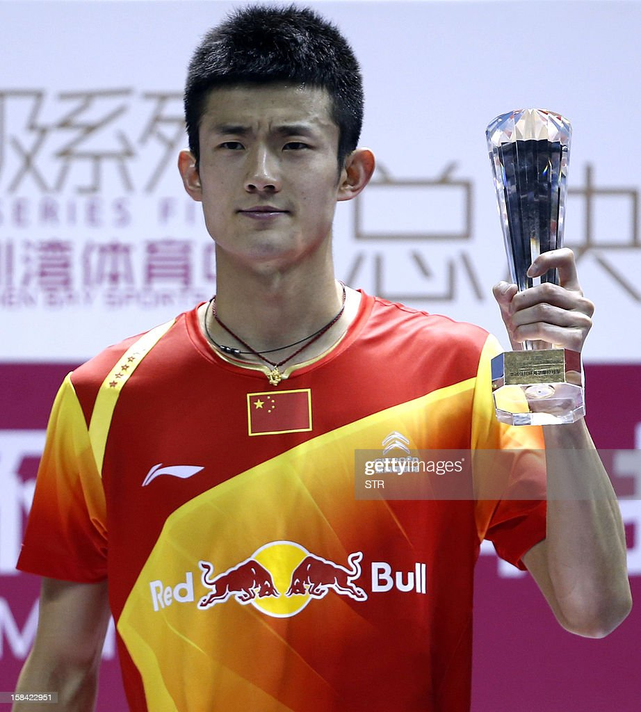 Chen Long of China poses with his trophy during the award ceremony
