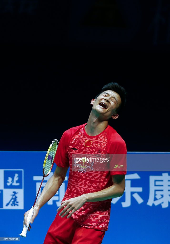 Chen Long of China reacts during the men's singles final match against Lee Chong Wei of Malaysia at the 2016 Badminton Asia Championships in Wuhan, central China's Hubei province on May 1, 2016. / AFP / STR / China OUT