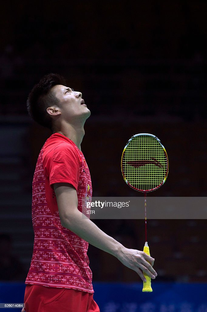 Chen Long of China reacts during the men's singles quarter-final match against Tommy Sugiarto of India at the 2016 Badminton Asia Championships in Wuhan, central China's Hubei province on April 29, 2016. / AFP / STR
