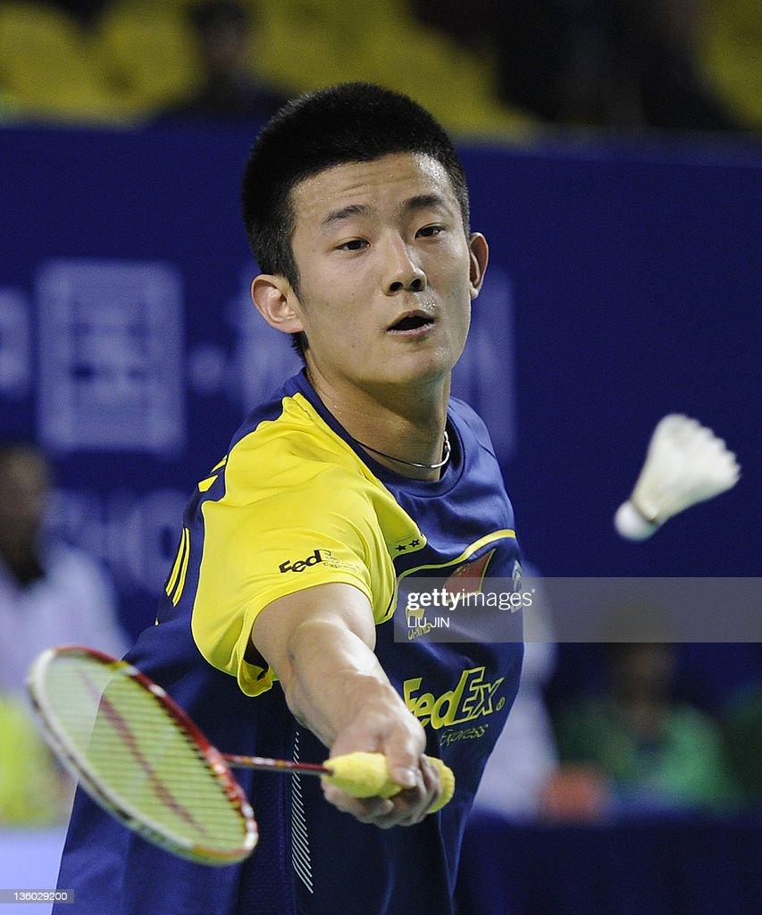 Chen Long of China returns a shuttlecock