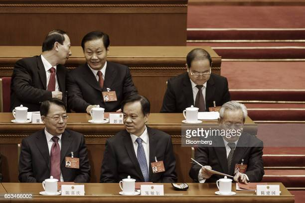 Chen Min'er Chinese Communist Party Secretary of Guizhou Province front center attends the closing ceremony of the National People's Congress in...