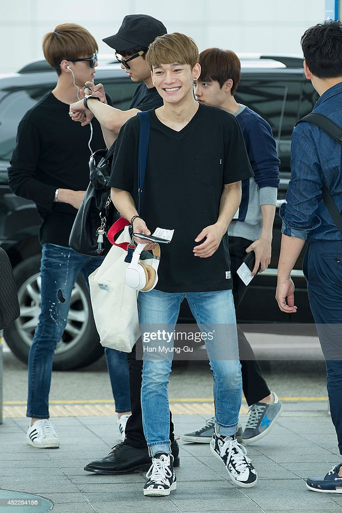 Chen of boy band EXOM is seen on departure at the Incheon International Airport on July 17 2014 in Incheon South Korea