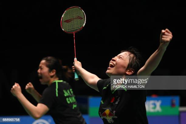 Chen Qingchen and Jia Yifan of China celebrate their victory in the women's doubles Sudirman Cup match against Misaki Matsutomo and Ayaka Takahashi...