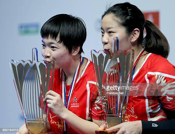 Chen Qingchen and Jia Yifan of China celebrate with their trophies after winning the women's doubles final match against Ayaka Takahashi and Misaki...