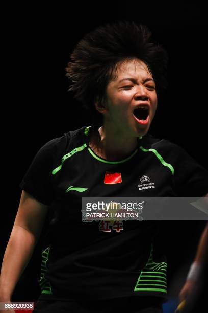 Chen Qingchen of China reacts during the mixed doubles Sudirman Cup match with partner Zheng Siwei against Arisa Higashino and Yuta Watanabe of Japan...