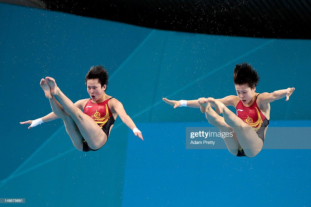 Chen Roulin and Hao Wang and of China compete in the Women's Synchronised 10m Platform Diving on Day 4 of the London 2012 Olympic Games at the...