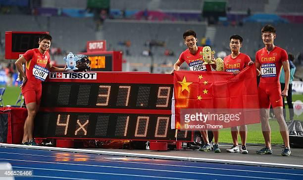 Chen Shiwei Xie Zhenye Su Bingtian and Zhang Peimeng of China celebrate claiming the Gold medal in the Men's 4x100m Relay Final during day thirteen...
