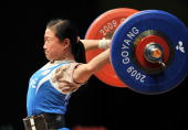 Chen WeiLing of Taiwan misses a lift during the women's 48Kg category of the World Weightlifting Championships in Goyang north of Seoul on November...