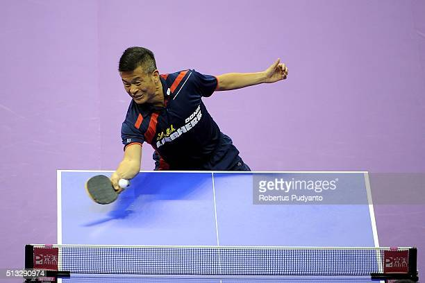 Chen Weixing of Austria competes against Xu Xin of China during the 2016 World Table Tennis Championship Men's Team Division Round 5 match at...