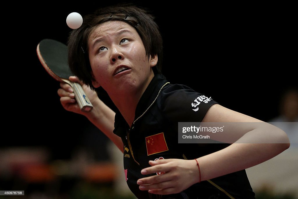 Chen Xingtong of China serves against Feng Tianwei of Singapore during their Women's Singles match on day two of 2014 ITTF World Tour Japan Open at Yokohama Cultural Gymnasium on June 21, 2014 in Yokohama, Japan.