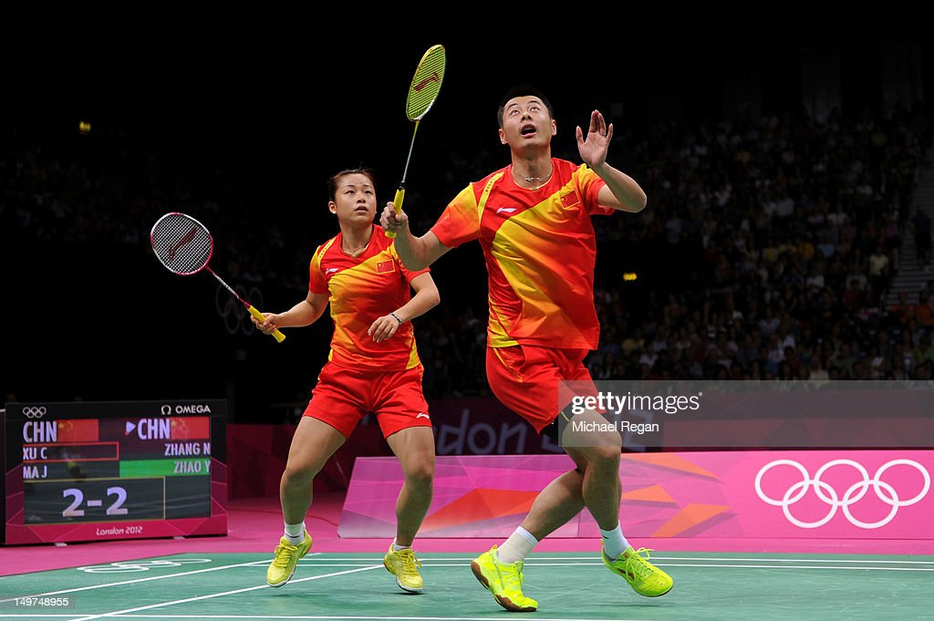 Chen Xu (R) and Jin Ma of China compete in the Mixed Doubles Badminton Gold Medal match against compatriots Nan Zhang and Yunlei Zhao of China on Day 7 of the London 2012 Olympic Games at Wembley Arena on August 3, 2012 in London, England.