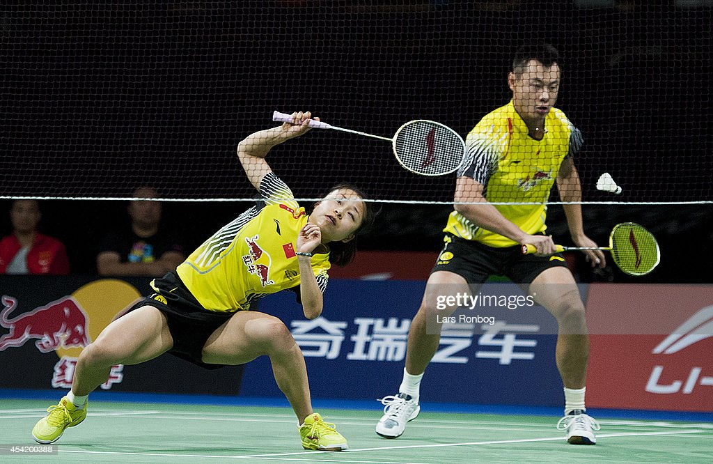Chen Xu and Jin Ma of China in action during the LiNing BWF World Badminton Championships at Ballerup Super Arena on August 26 2014 in Copenhagen...