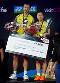 Chen Xu and Jin Ma of China on the podium receiving gold after the Mixed Double final during the Yonex Denmark Open MetLife BWF World Superseries at...