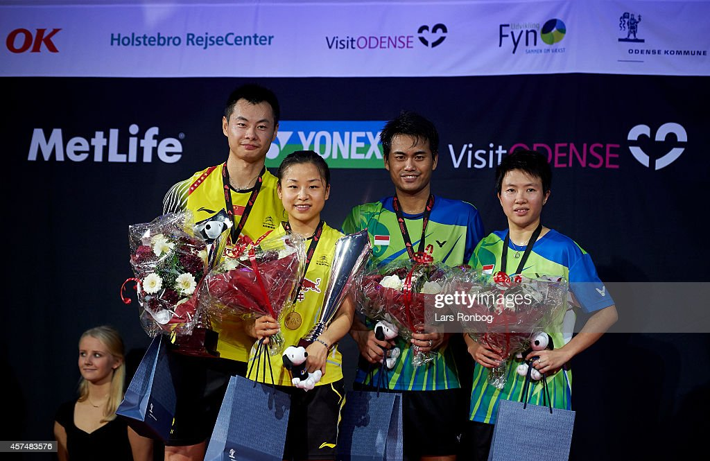 Chen Xu and Jin Ma of China on the podium receiving gold and Tontowi Ahmad and <a gi-track='captionPersonalityLinkClicked' href=/galleries/search?phrase=Liliyana&family=editorial&specificpeople=4055313 ng-click='$event.stopPropagation()'>Liliyana</a> Natsir of Indonesia receiving silver after the Mixed Double final during the Yonex Denmark Open MetLife BWF World Superseries at Odense Idratspark on October 19, 2014 in Odense, Denmark.