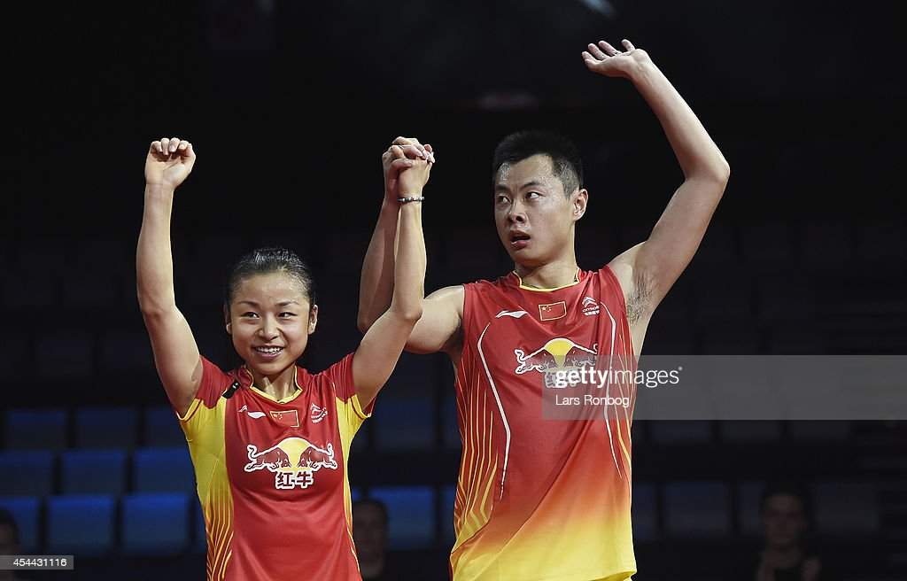 Chen Xu and Jin Ma of China on the podium receiving their silver medal in the mixed double against Nan Zhang and Yunlei Zhao of China in the finals during the Li-Ning BWF World Badminton Championships at Ballerup Super Arena on August 31, 2014 in Copenhagen, Denmark.