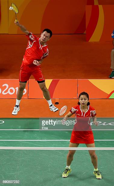 Chen Xu and Jin Ma of China return a shot to Yunlei Zhao and Nan Zhang of China during the bronze medal Mixed Doubles match on Day 11 of the Rio 2016...