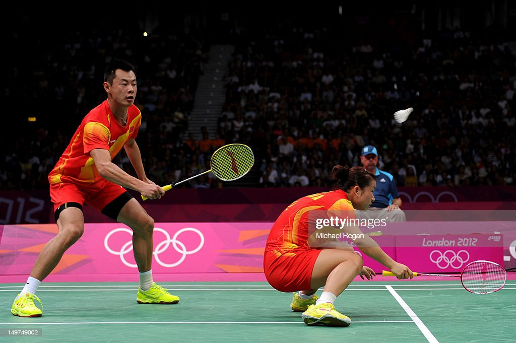 Chen Xu hits a shot over Jin Ma of China as they compete in the Mixed Doubles Badminton Gold Medal match against compatriots Nan Zhang and Yunlei...