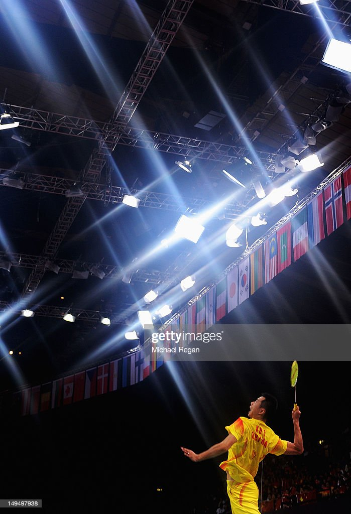 Chen Xu of China plays a smash against Peng Soon Chan and Liu Ying Gohon of Malaysia during their Mixed Doubles Badminton on Day 2 of the London 2012 Olympic Games at Wembley Arena on July 29, 2012 in London, England.