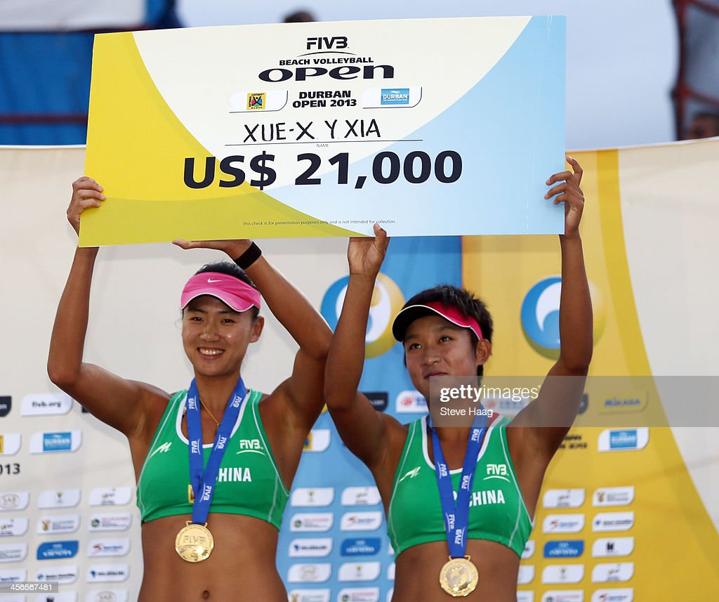 Chen Xue (L) and Xinyi Xia of China hold their winnings during the medals ceremony at the FIVB Durban Open at New Beach on December 14, 2013 in Durban, South Africa.