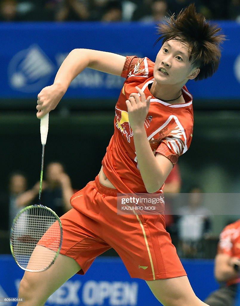 Chen Yufei of China returns a shot against Thailand s Busanan