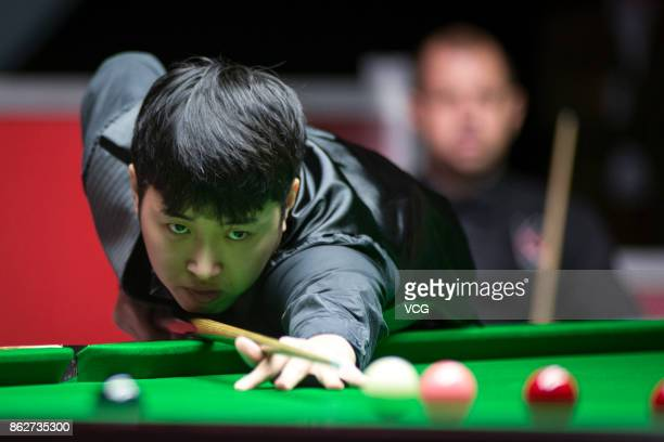 Chen Zifan of China plays a shot during his second round match against Barry S Hawkins of England on day three of 2017 Dafabet English Open at...